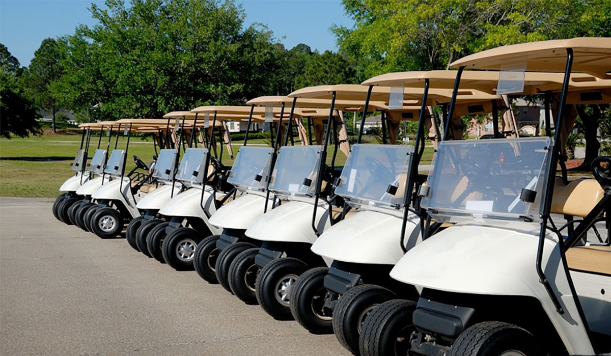 Row of parked golf carts at golf course