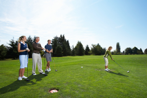 Four players in a golf tournament